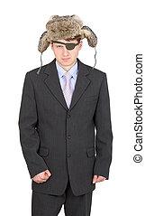 Dismal russian businessman in the fur hat