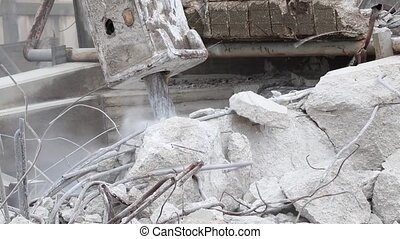 Dismantling structures with a rock breaker including sound