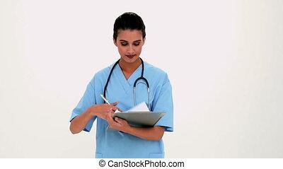 Dismayed beautiful nurse filling a - Dismayed beautiful...