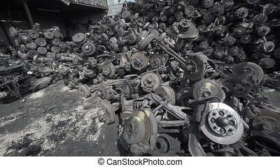 Disorganized Heap of Castoff Car Axles and Wheel Parts -...
