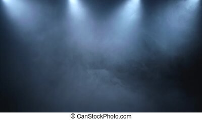 Dispersion of smoke on a black background with low lighting fittings
