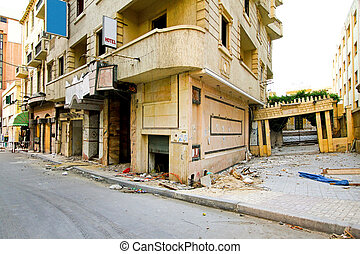 Displaced earthquake building - Abandoned building after...