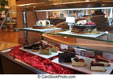 Display cakes - Selection of cakes in a display case in a...