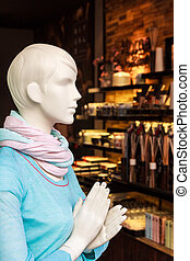 Display dummy in front of a store