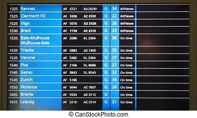 glowing display information board in Paris airport