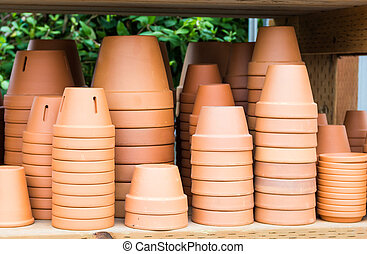 Display of clay or terracotta pots - A display of clay or...