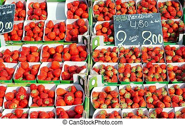 display of strawberries in a market