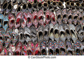Display of traditional shoes at the street market in Jaipur, India