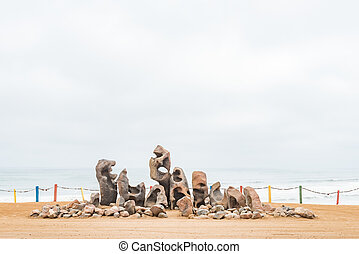 Display of weathered rocks on a dune in Henties Bay