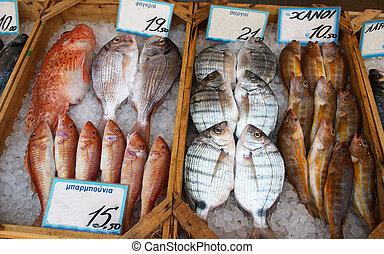 Greek fishmonger's - Display on a Greek fishmonger's slab.