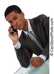 Displeased businessman slamming fist on desk