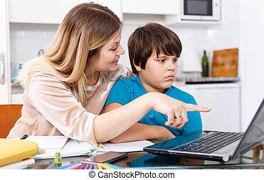 Displeased family doing homework