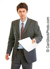 Displeased modern businessman showing document