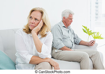 Displeased relaxed senior couple at home - Displeased ...