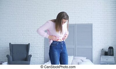Displeased woman looking at body after weight gain -...