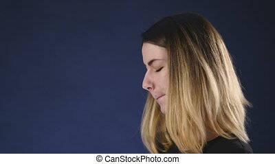 Displeased woman speaks on the phone
