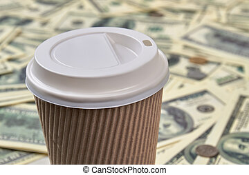 Disposable cup of coffee, close up.