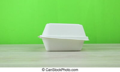 Disposable Eco Cardboard Food Container. Dolly Out shot with...