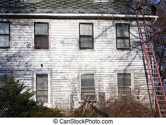 Older house in state of disrepair.