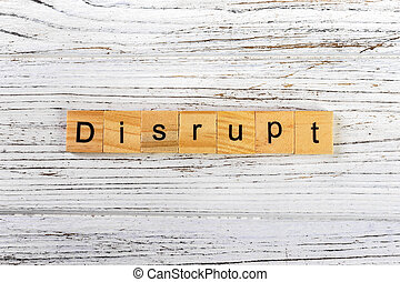 DISRUPT word made with wooden blocks concept