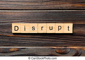 DISRUPT word written on wood block. DISRUPT text on wooden table for your desing, concept