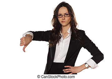 dissatisfied and angry business woman showing thumbs down