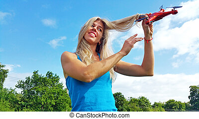 blonde woman with tangled hair drone