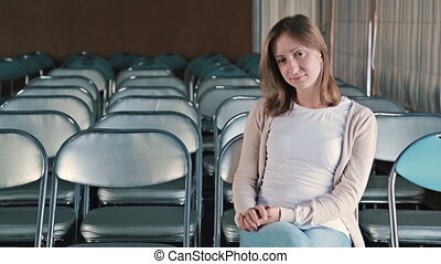 Dissatisfied young woman applauding