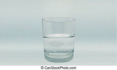 Dissolving tablets in a glass with water