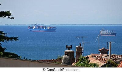 Distant container cargo ships in the sea harbour - Distant...