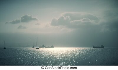 Distant sailboats and cargo ships near Gibraltar - Distant...