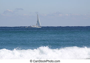 Distant Sailing - A sailboat in the distance.