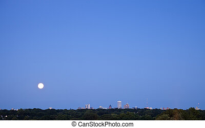 Distant view of Milwaukee with full moon