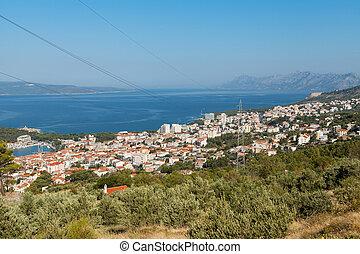 Makarska - Distant view of the city of Makarska, popular ...