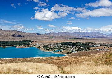 Distant view of the town of Tekapo on the shore of Lake Tekapo