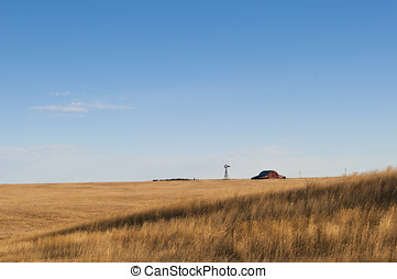 Distant Wyoming Barn - Barn and windmill on the highplains...