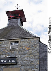 Distillery in Scotland - The classic pagoda-topped roof of a...