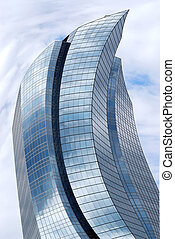 Distorted futuristic corporate building with glass walls reflecting clouds