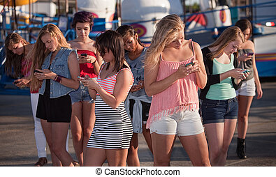 Distracted Girls Texting - Eight teenage girls distracted...