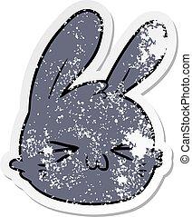 distressed sticker of a cartoon rabbit face