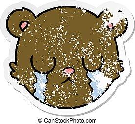 distressed sticker of a cute cartoon teddy bear face crying