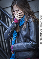 Young Crying Teen Aged Girl on Staircase - Distressed Young...