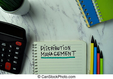 Distribution Management write on a book isolated on office desk.