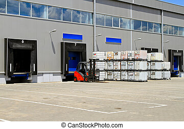 Distribution warehouse - Forklift vehicle in front of cargo ...