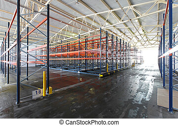 Distribution warehouse - Mobile roller shelving system in ...