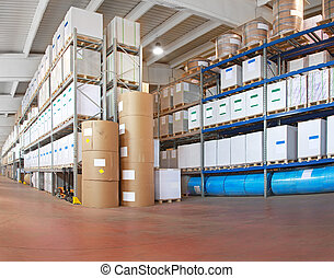 Distribution warehouse with paper rolls and material for ...
