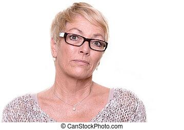 Distrustful stern middle-aged woman