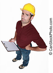 Distrustful tradesman with a clipboard