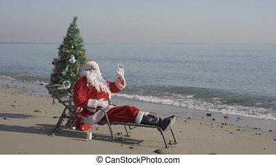 dit, mer, claus, s'étend, noël, santa, joyeux, félicite, arbre, main, célébrer, ou, plage, onduler, sunbed