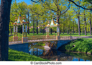 Ditch with bridge in the park of Pushkin near St. Petersburg on a sunny summer day